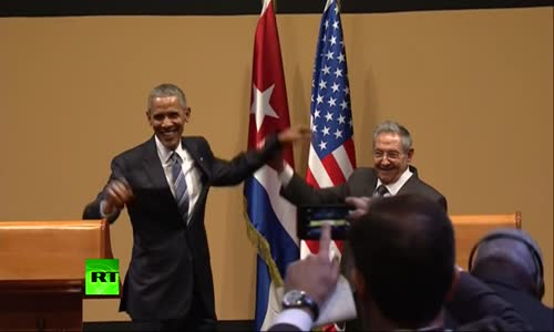 No hugs for Obama- Awkward moment with Castro at Havana presser.