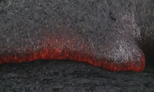 Raw Molten lava consumes shrubs in Pahoa