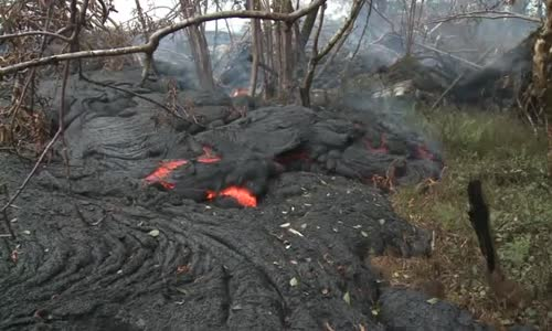 Raw Lava covers headstones in Hawaii cemetery