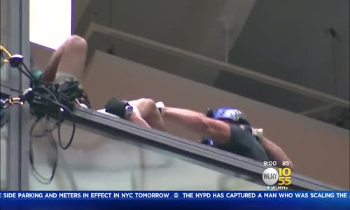 Man Scales Trump Tower