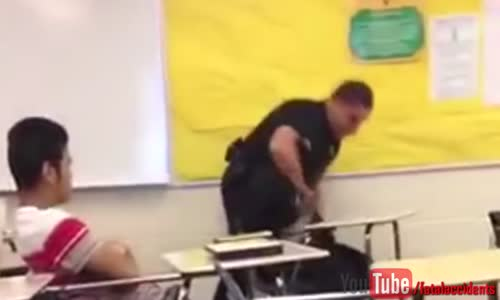 Cop Violently Attacks Peaceful Female Student