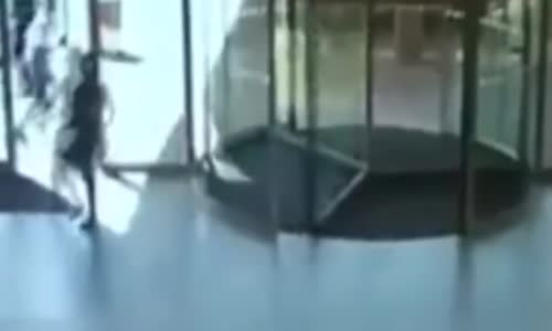 Shoplifting Woman Slams into Revolving Glass Door