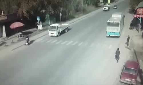 Mother and child cross the road in Kazakhstan