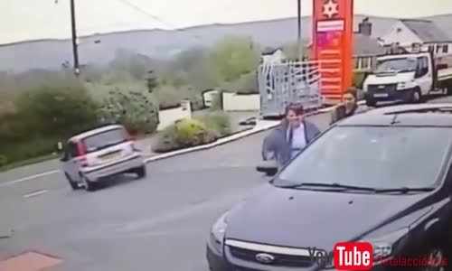 Elderly Woman Driver Exits Petrol Station