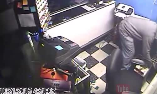 Shop owner fights off robber with hammer