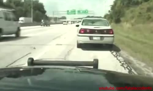 Cop drags suicidal man from road after running onto the highway