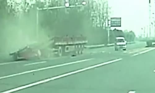Truck gets crushed by it's own cargo