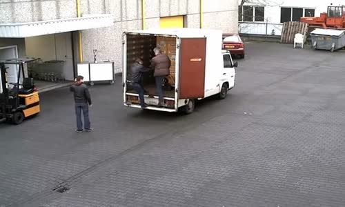 Workers Drop Cases of Beer from Truck