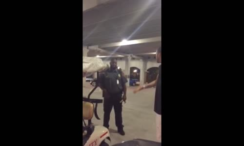 Security guard firing shots in parking garage
