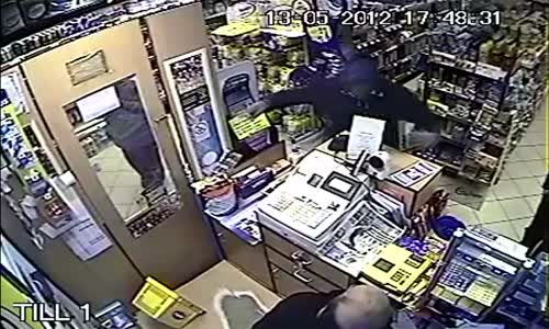 Shopkeeper beats robber with folding chair