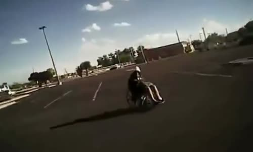 Cop Gets A Work Out Helping Lady In Wheelchair