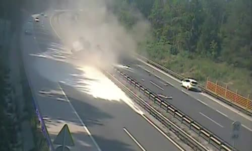 Semi truck's tire explodes driving on highway