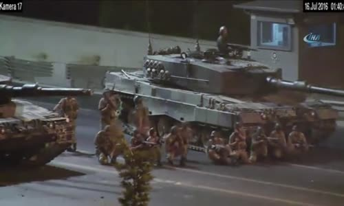 Tanks and soldiers firing at protestors