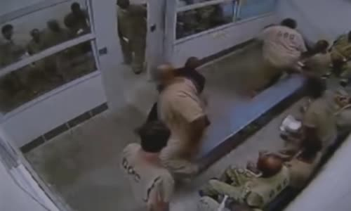 Cook County Jail guard beating combative prisoner