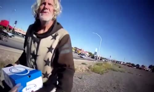 Police Officer Helping Homeless Man