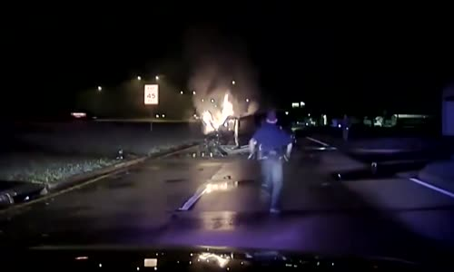 Police Officers Pull Man From Burning Car