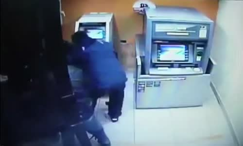 Thieves use JCB digger to rip ATM