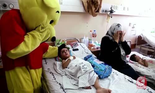 كلنا غزة (توزيع هدايا على الأطفال المصابين)  