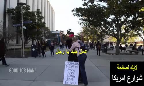 شاهد ماذا فعل هذا الشاب الامريكى فى الشارع فى نفسه تضامنا مع ما يحدث فى سوريا _ لن تصدق
